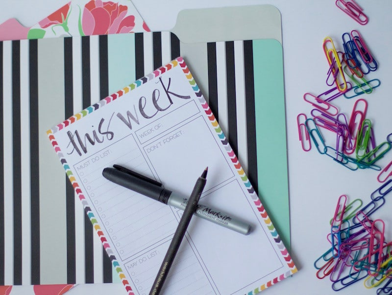 Colorful file folders and paper clips with a to-do list and pens. #officeorganization