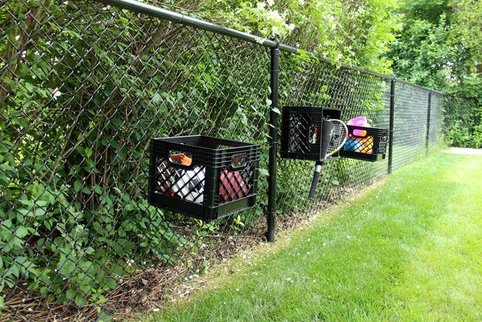 Outdoor Toy Storage Solutions - Baskets On Fence