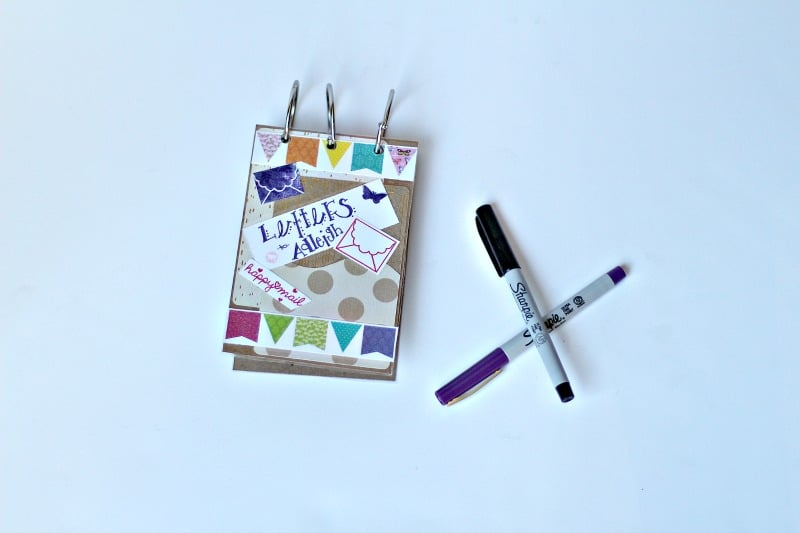 Finished memory book cover next to markers #diy