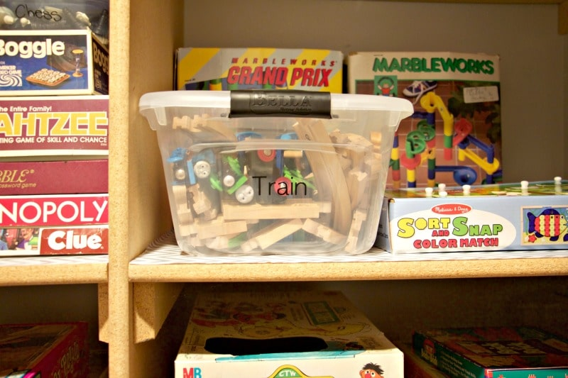 Labeled bin full of train pieces #gameorganizing