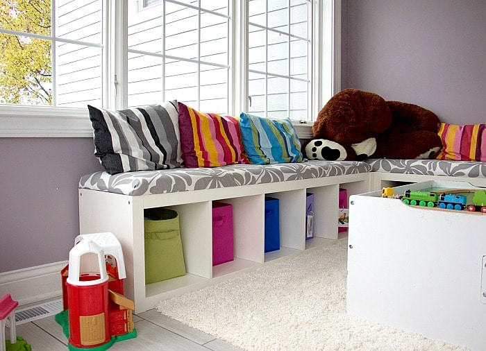 Window seat with pillows and toys #playroom
