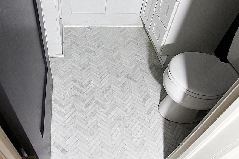 herringbone bathroom floor tile