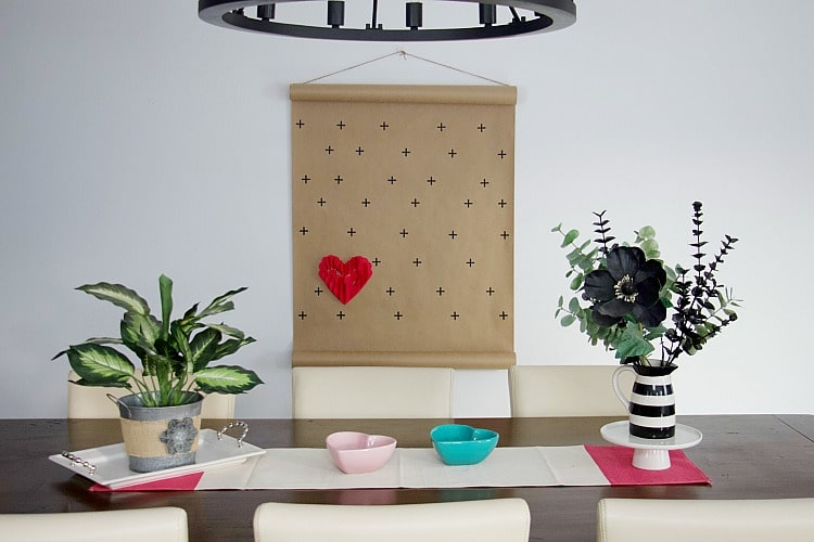 This easy tutorial for creating Valentine decorations can add a touch a love to your home for the holiday. Learn how to create 3-D heart art for the wall! #valentinesday #hearts #wallart