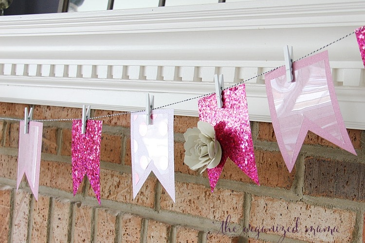 Give your home some pink for spring with these easy spring mantel decor ideas. Use the Xyron Creative Station to turn paper into stickers and add a banner to your mantel, along with adding greens and pops of pink! #manteldecor #spring