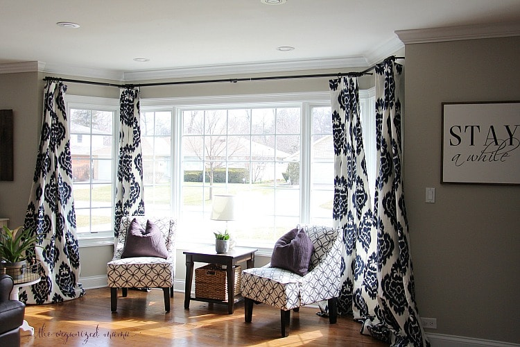 Have an oversized bay window? Try these tricks for hanging bay window curtains and curtain rods when nothing else will work! #baywindow #DIY #curtains