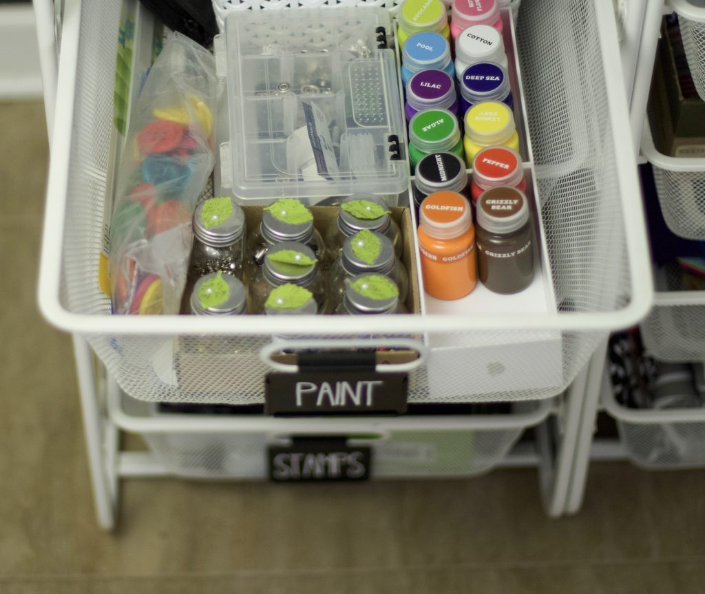 Paints and craft supplies organized in drawers. Use labels to keep drawers organized and everyone can find what they are looking for. #drawerorganization #professionalorganizer