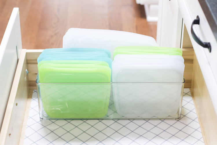 Reusable bags are stored in a deep drawer to demonstrate alternative to Ziploc bags and how to store them #sustainable #organized