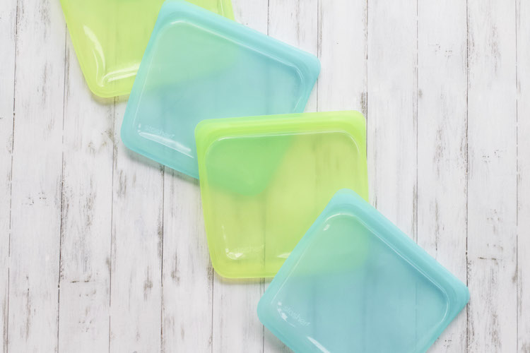 Stashers reusable bags in green and teal laying on floor to demonstrate alternatives to Ziploc bags #sustainable #reusable