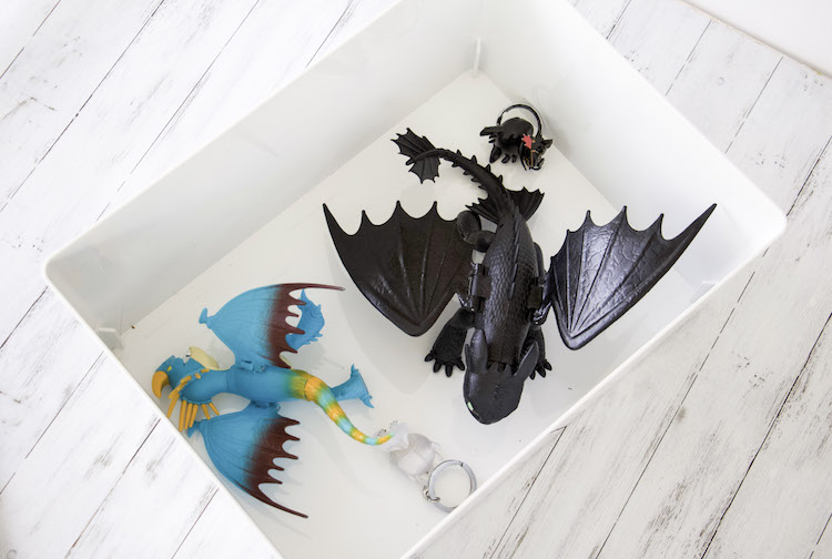 Looking down into a container with dragons from How To Train Your Dragon 3 for easy toy storage