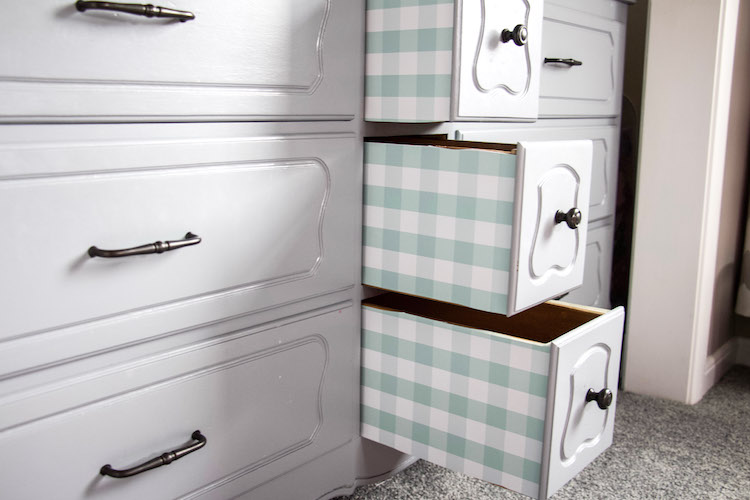 Three drawers pulled out with drawer liners on the outside of each drawer using Duck Brand shelf liner #organized