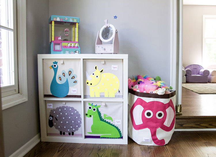 Playroom organization with 3 Sprouts bins in different animal prints in bright colored patterns to hold toys. #organized