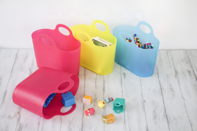 four mini party totes storing shopkins characters, hachibabies, and pearler bead creations to demonstarte how to store tiny toy trinkets.