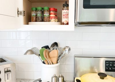 kitchen cabinet with spices declutter