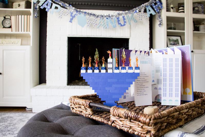 lego menorah with happy hanukkah on mantel