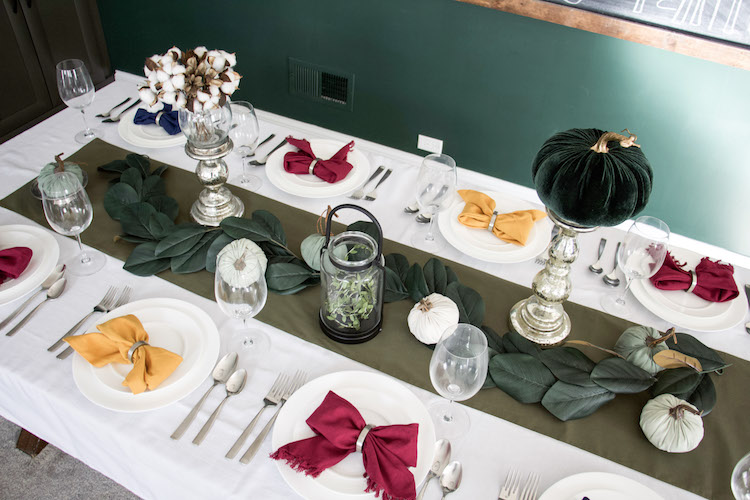 thanksgiving table decor by repurposing halloween items like pumpkins and candles
