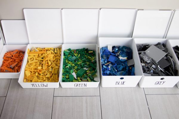 close up of color-coded bins with legos inside