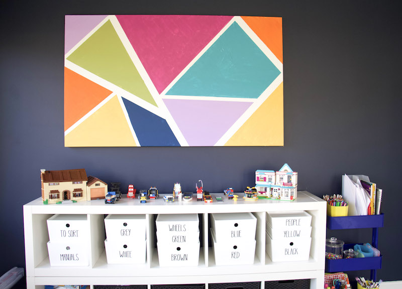 playroom decor with painting and lego storage