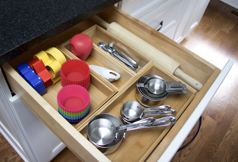 organizing kitchen utensils baking items stored in bamboo boxes #organize #kitchen #sustainable