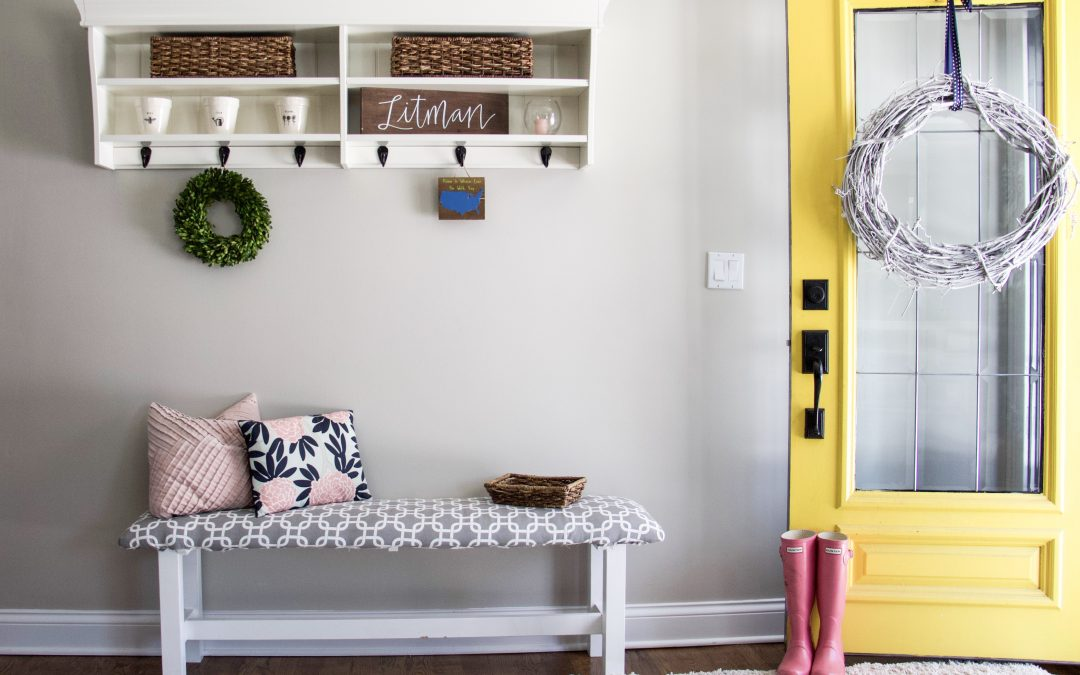 Entryway with yellow door and pink boots #organizedkids