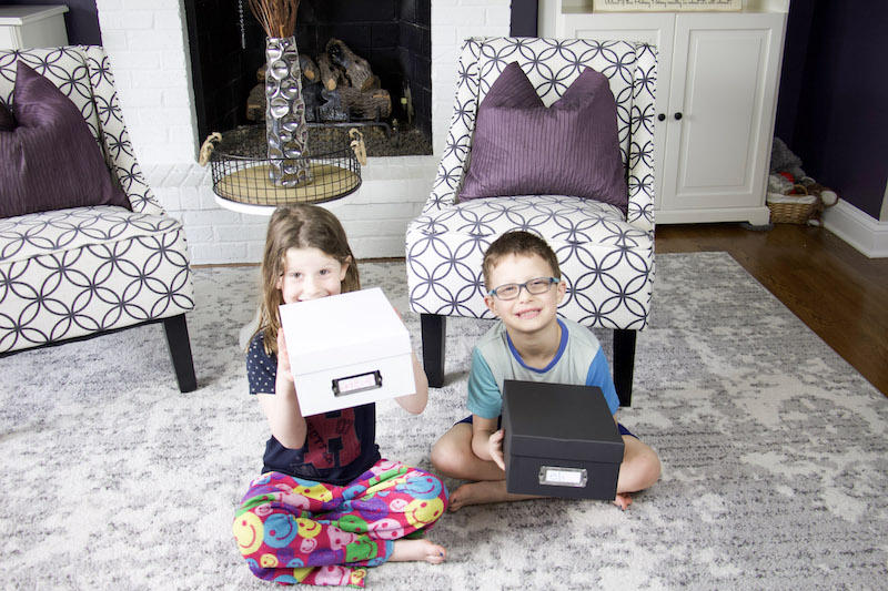 kids holding their photo boxes to demonstrate how to organize photos with joann stores