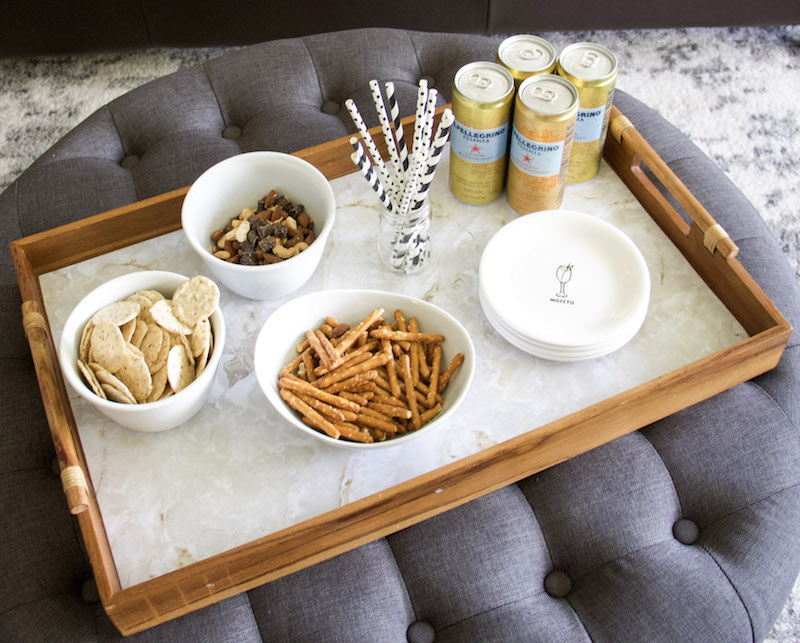 snack tray on ottoman with marble EasyLiner to protect and upcycle wooden tray
