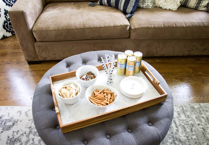 upcycle tray with snacks in front of couch