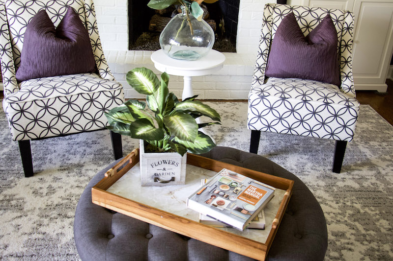 tray with books and plants near fireplace