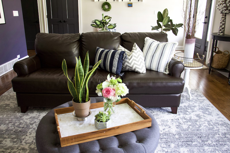 tray with EasyLiner and flowers in front of couch